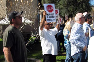 Peoria city worker Ed Thomas attended a capitol rally against 4 public union bills.