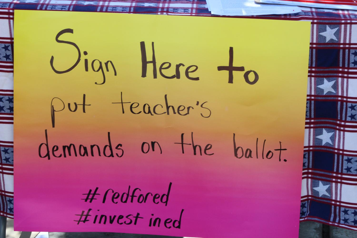 Invest in Education Act signature sign