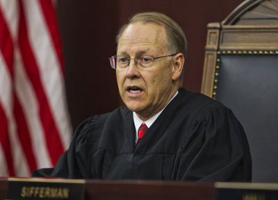Judge Bill O'Neil reads the decision from the Supreme Court bench.