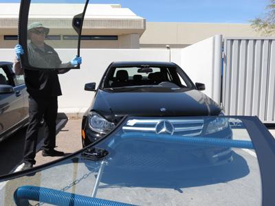 Penske Rapid Repair's Dave Hurdel replaces a windscreen at Mercedes of Chandler.
