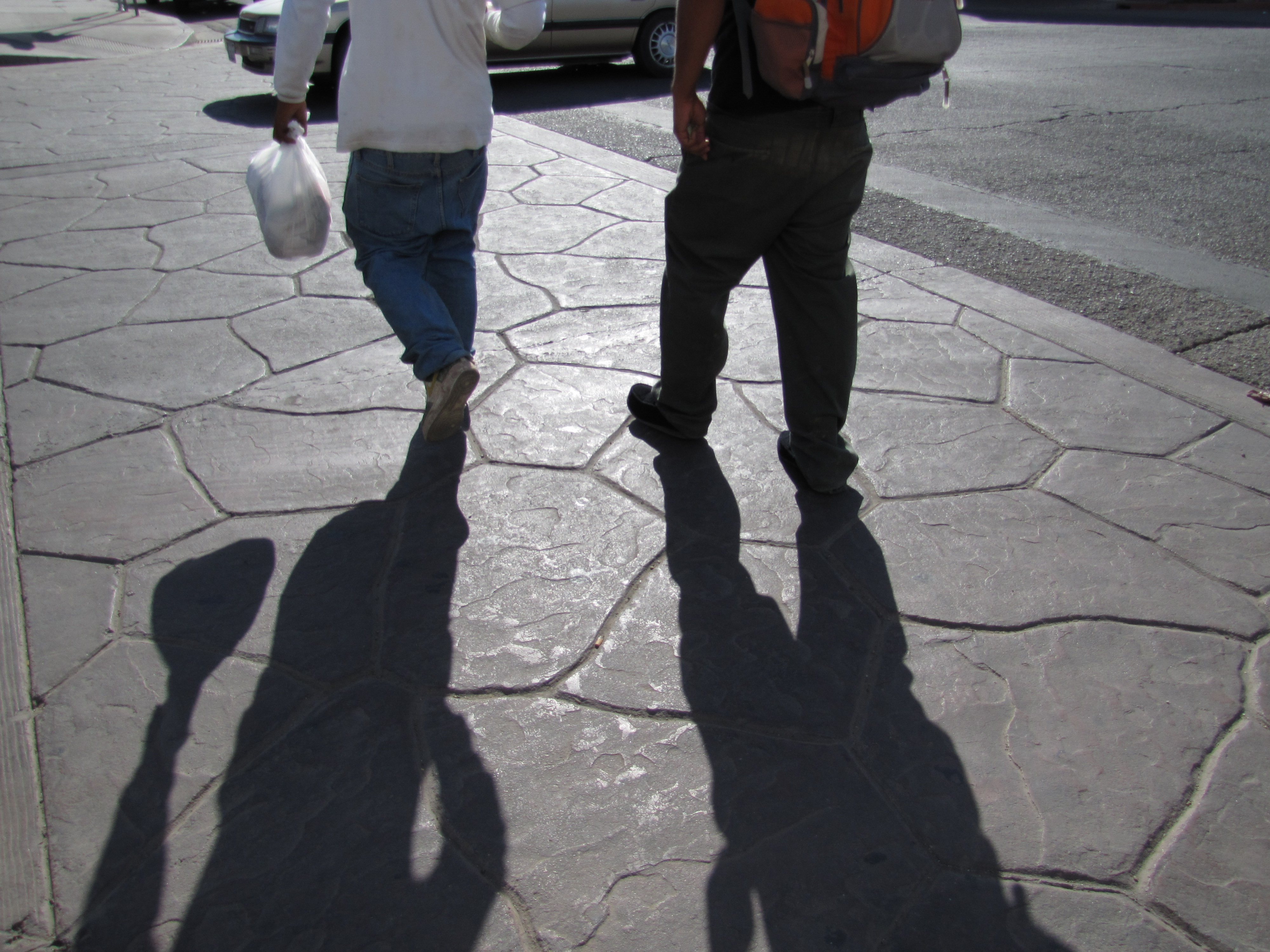 Two construction workers head back to Mexico through the Calexico border crossing after a day's work.