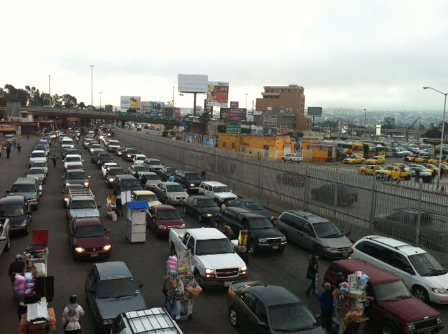 Dozens of cars line up in Tijuana waiting to be examined by Customs as they enter into the U.S.