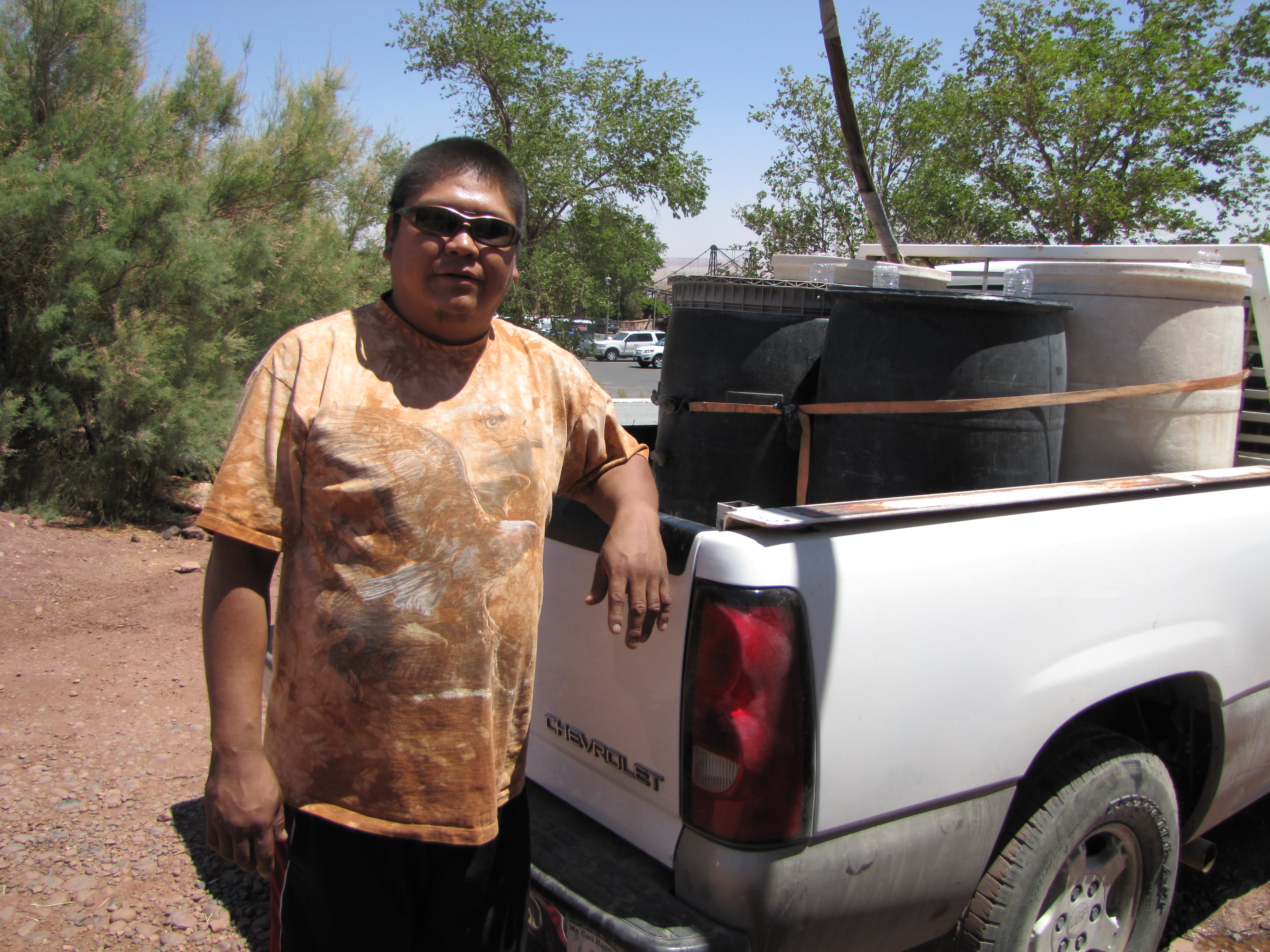 Ricky Jensen drives 12 miles to Cameron, AZ to get water for his grandmother's sheep and another 25 miles for drinking water.