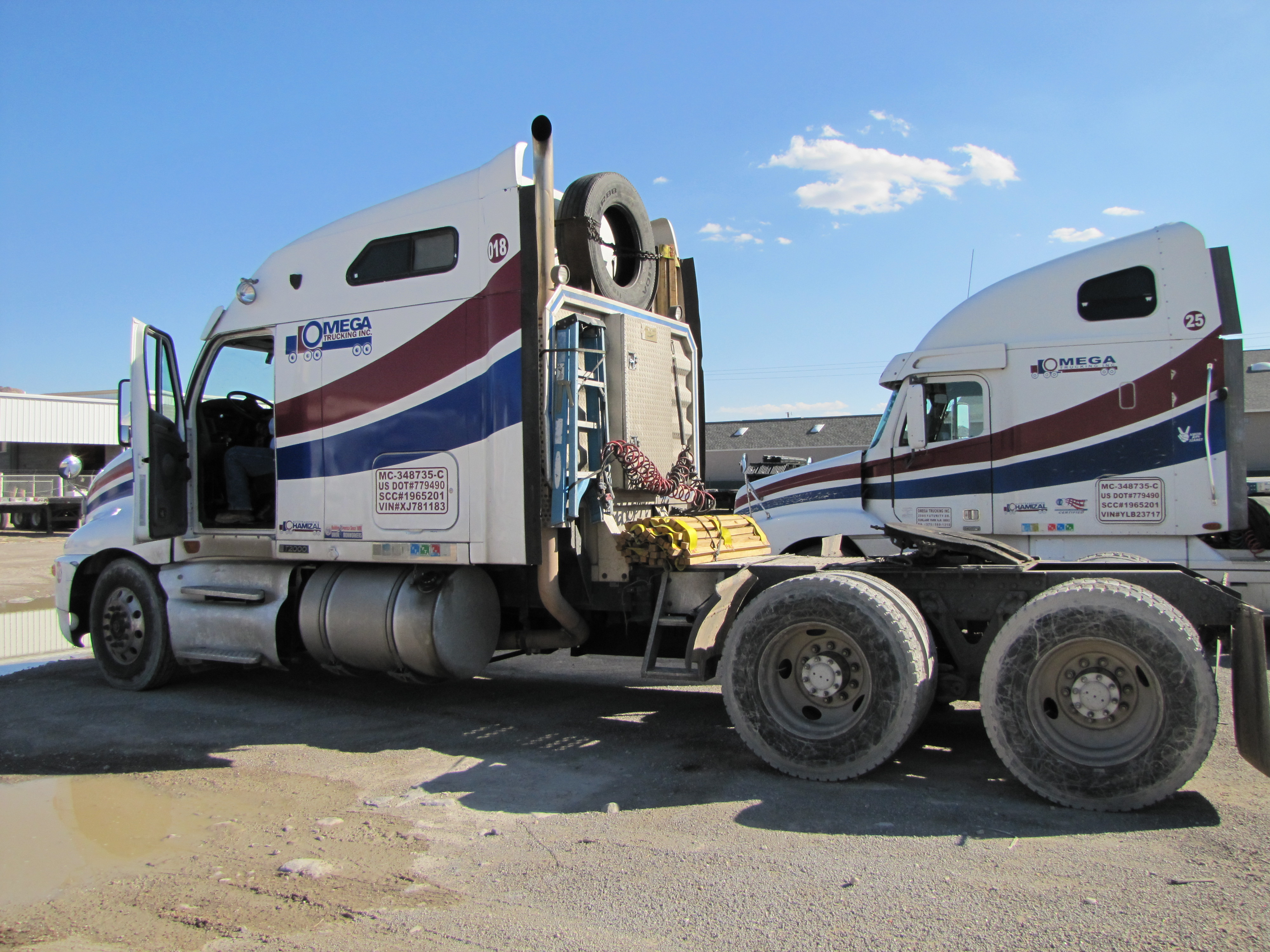 A truck used by Omega Trucking to transport construction material manufactured in Mexican factories across the United States.