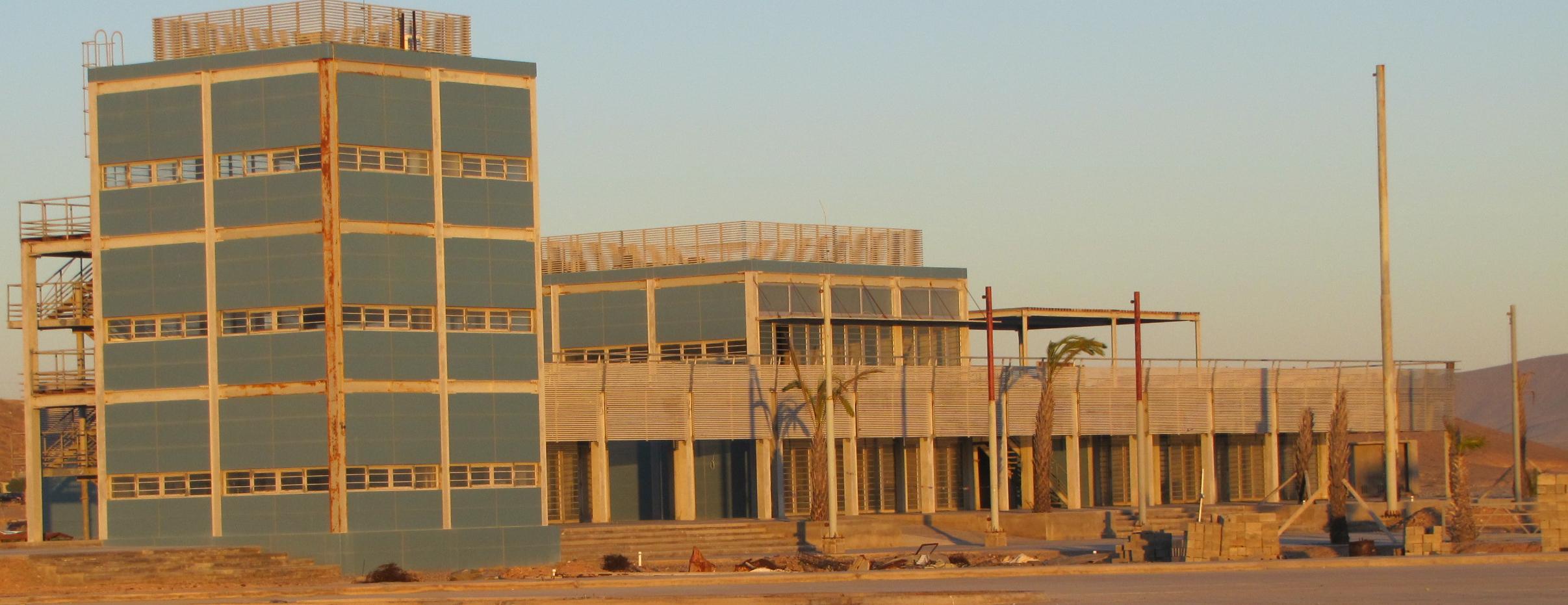 The buildings at the marina at Santa Rosalillita at sunset: they are rusting away.