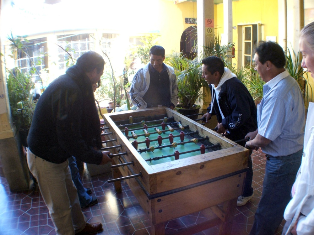 A few of the teachers playing foosball during a break from Spanish instruction.