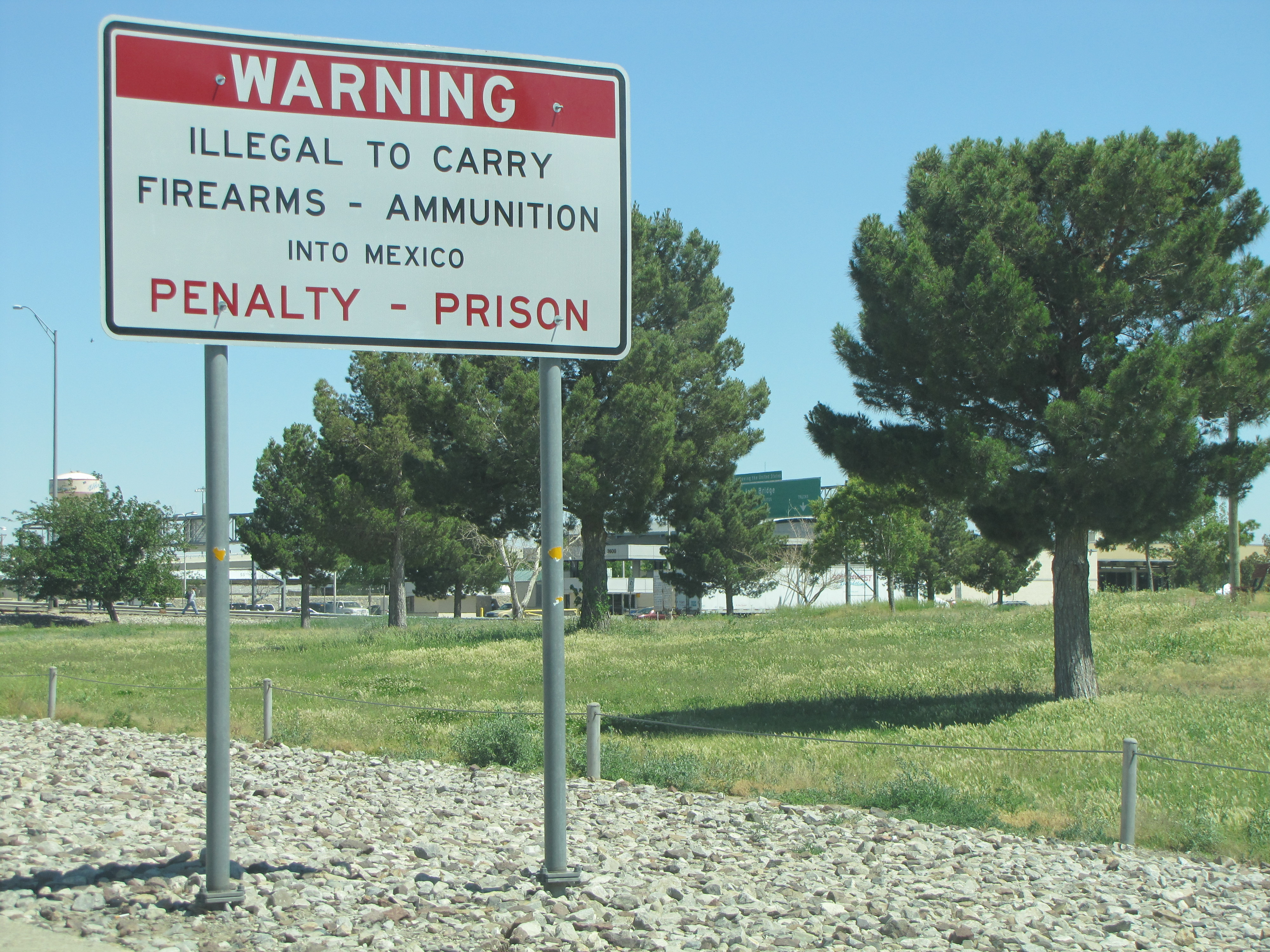 Warning signs like this one are posted along the multiple entrances to the international bridge to Mexico.