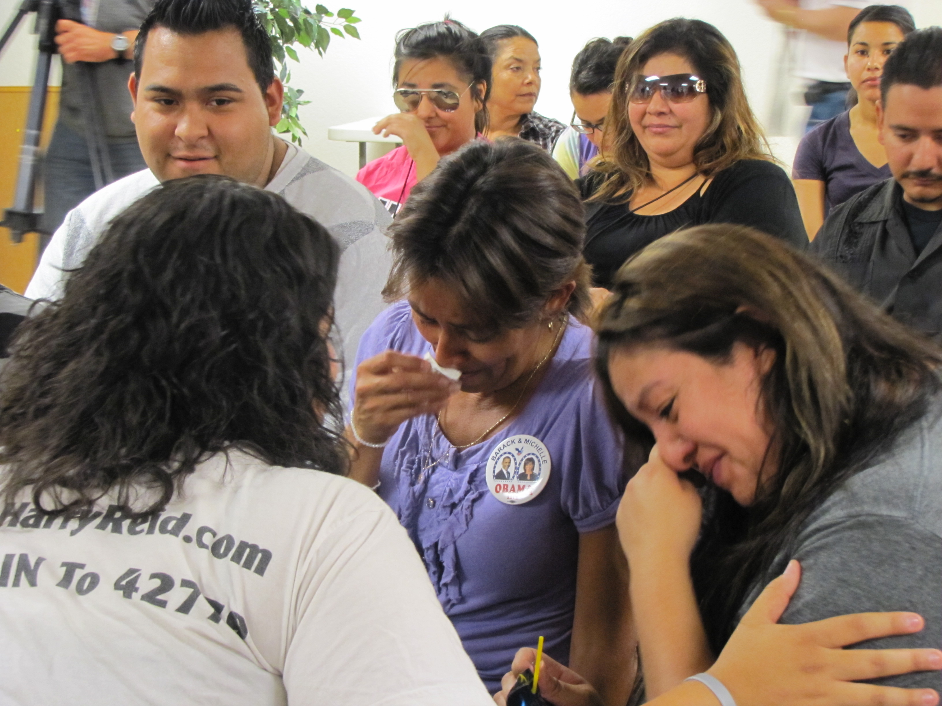 Activists and supporters of the DREAM Act react to President Obama's announcement on Friday in Las Vegas.