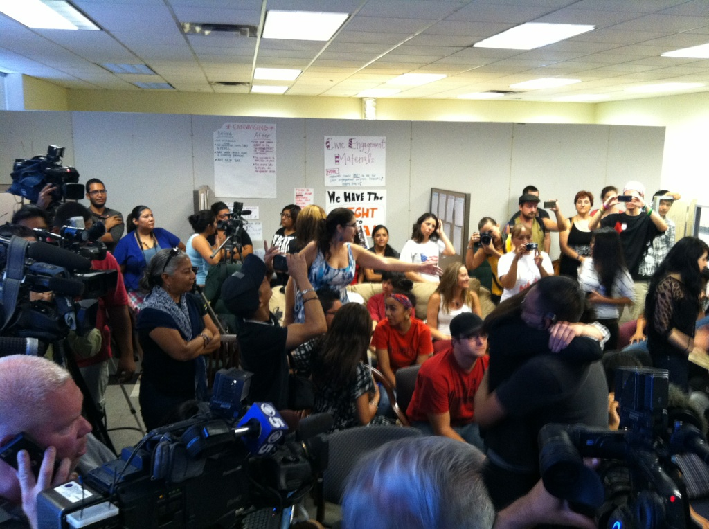 Media and supporters gather at the Phoenix headquarters of the Arizona Dream Act Coalition on Friday.