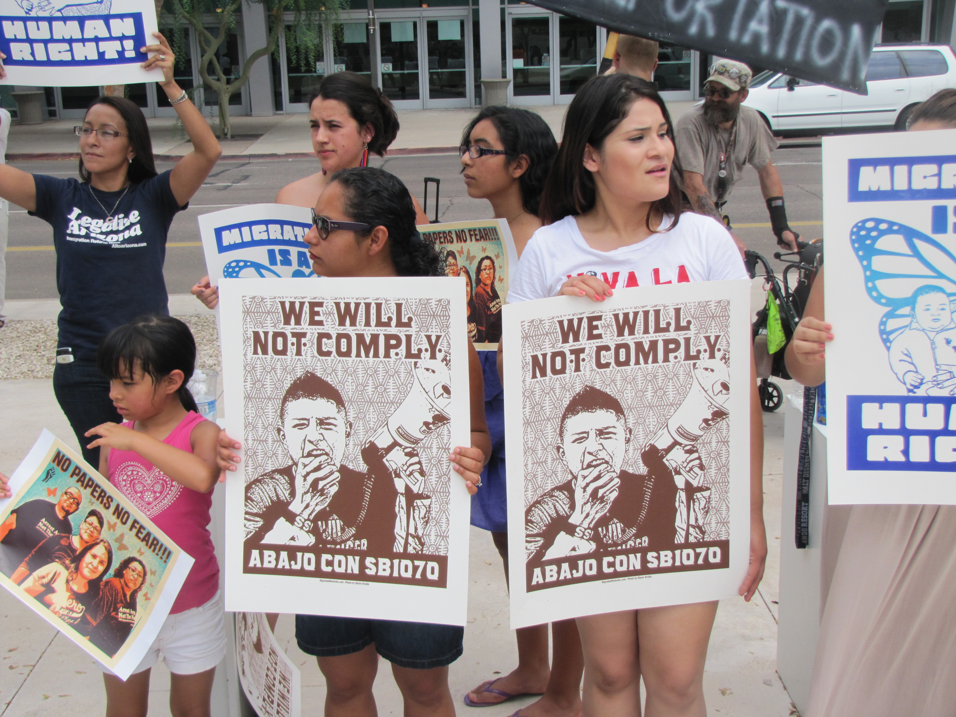 SB 1070 protesters gather outside the federal courthouse in Phoenix.