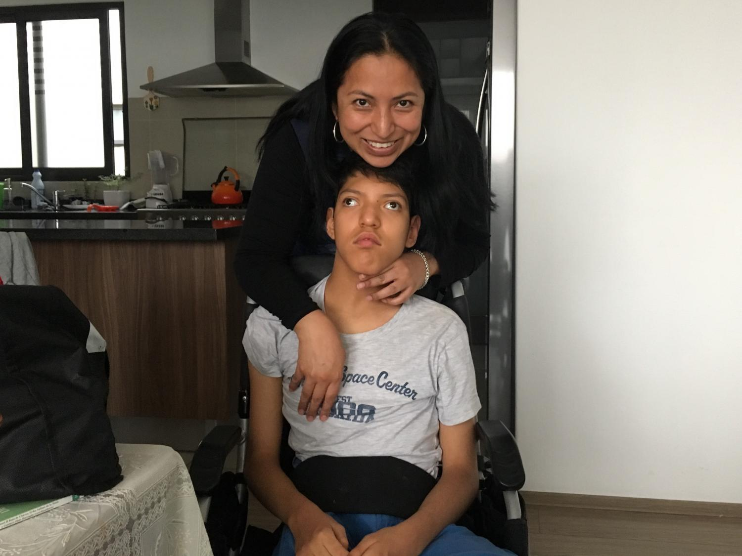 Margarita Garfias cares for her son Carlos Antonio in their middle-class neighborhood in Mexico City