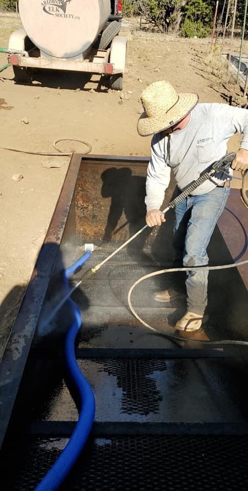 Arizona Elk Society power washes a catchment