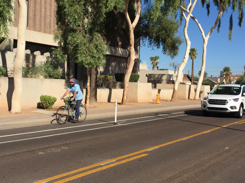 biker in protected bike lane