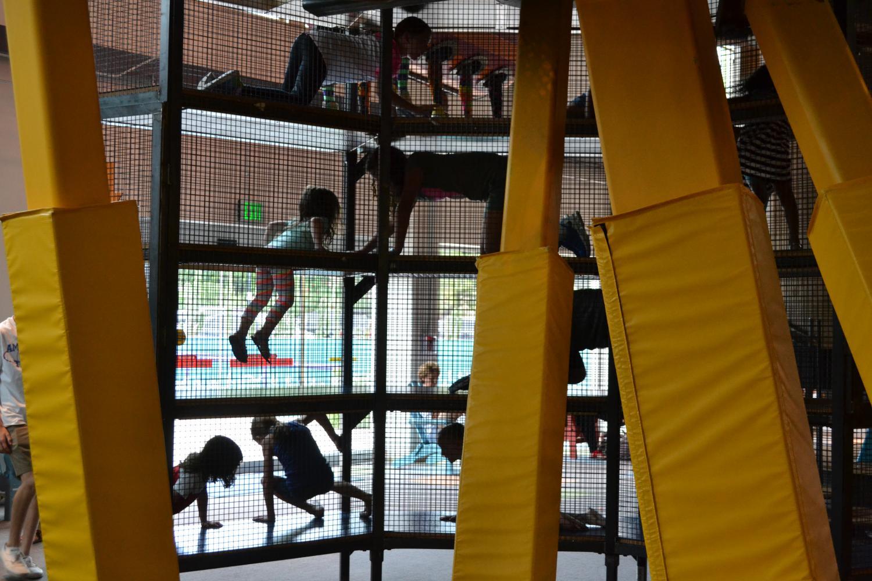 kids climb around at the museum