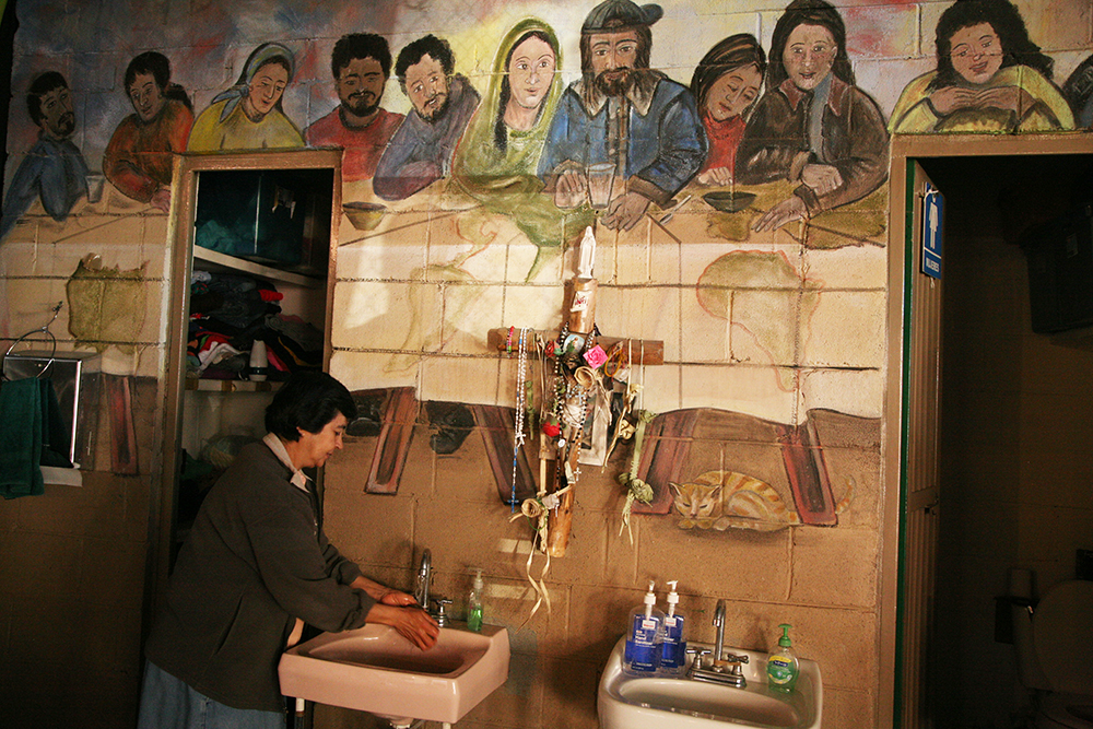 Woman washing hands at a soup kitchen in Mexico