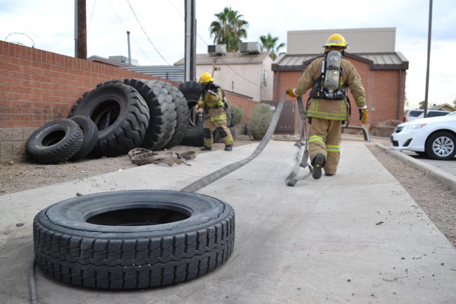 firefighter pulls tire