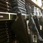 wall of blue jeans inside store