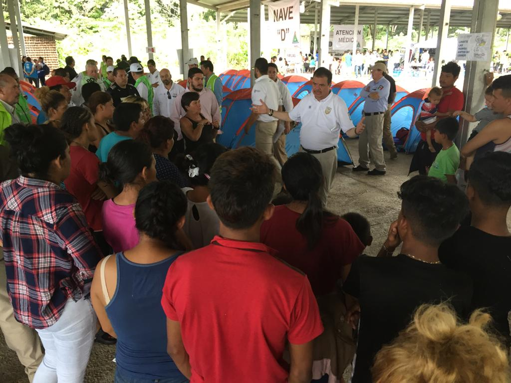 Personnel from the National Immigration Institute of Mexico provide instructions to the migrant caravan in a shelter in Chiapas.