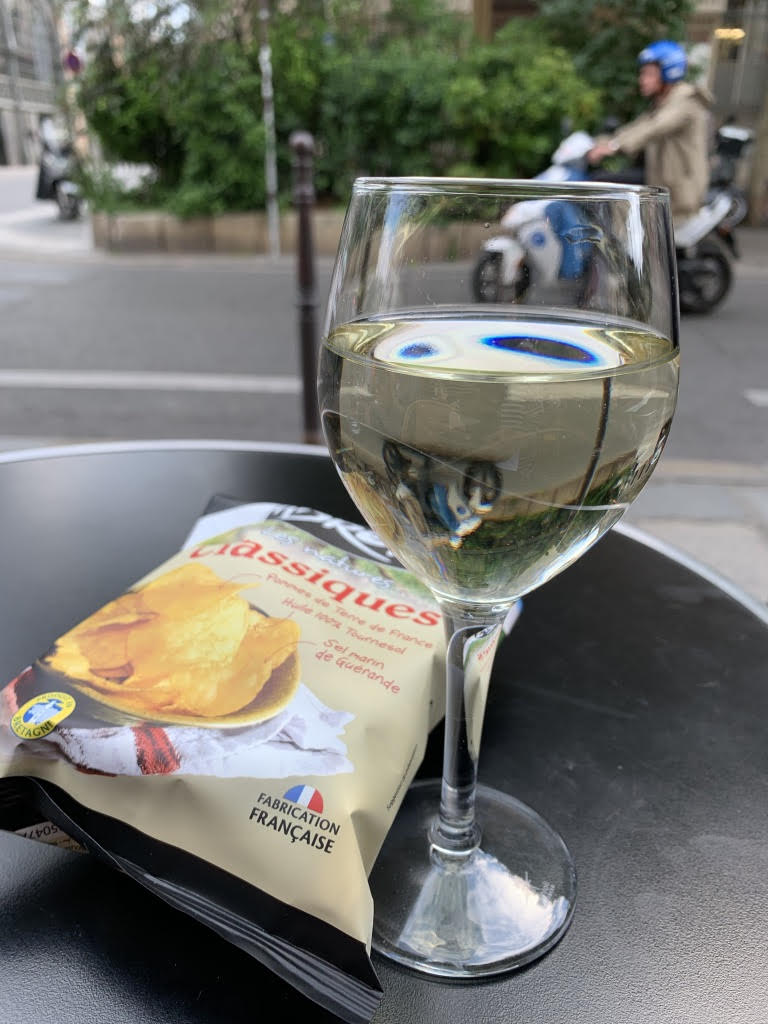 Glass of white wine with potato chips