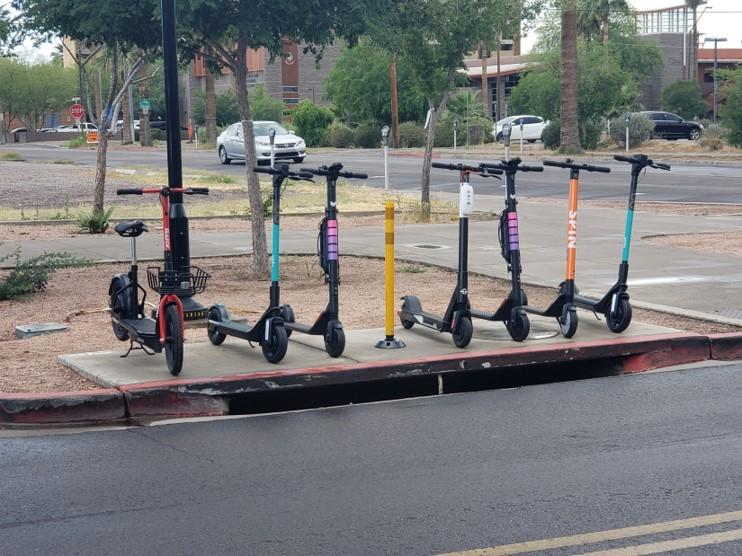row of parked scooters
