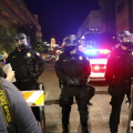 Phoenix police push crowds of protesters away