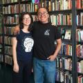 couple smiling by books