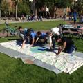 Arizona students handprints to a banner