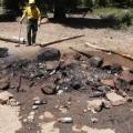 An unattended camp fire in Coconino National Forest.