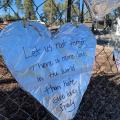 Foil heart on fence after hate crime.