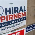 Signs for Rep. David Schweikert and challenger Hiral Tipirneni