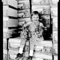 child sitting on packing crates