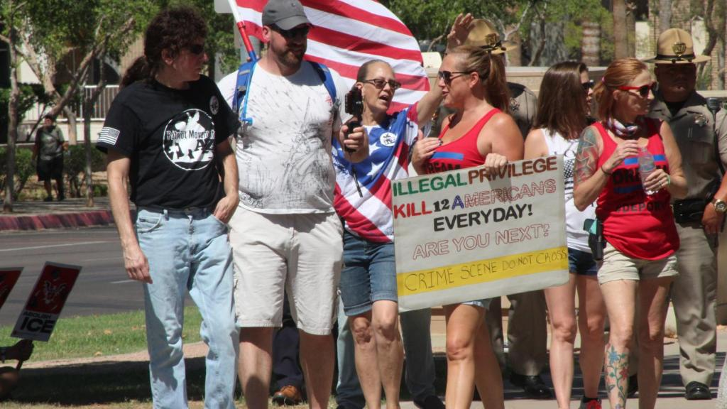 """Counter-protesters came to the event saying """"deport families together."""""""