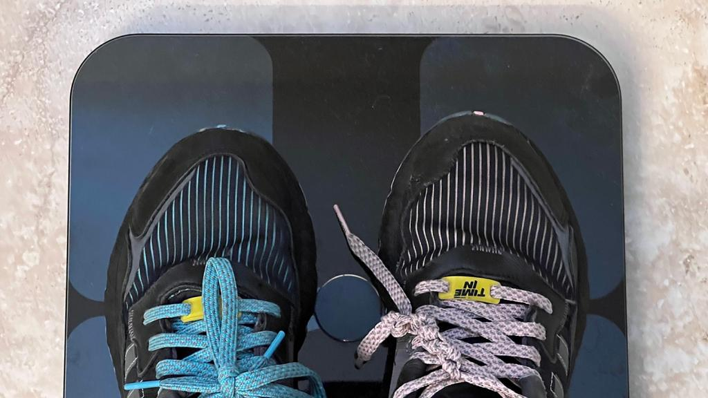Childhood obesity kids shoes on scale