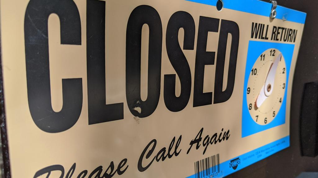 A closed sign on a business