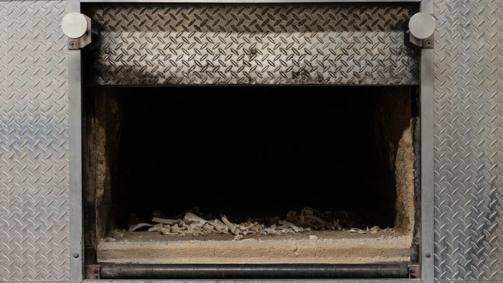 Cremated remains in crematorium incineration chamber