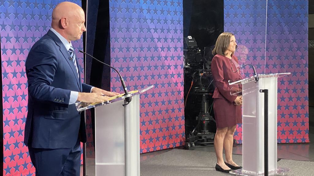 Mark Kelly and Sen. Martha McSally before the debate