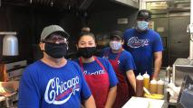 masked workers looking at camera