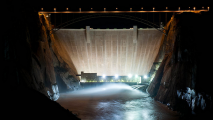 A night view of an experimental high flow at Glen Canyon Dam in 2012.