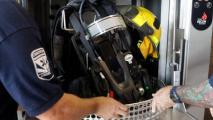 firefighter equipment going into washer