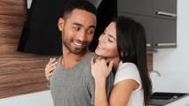 Couple hugging cuddling in kitchen