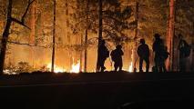 Firefighters fighting the Backbone Fire