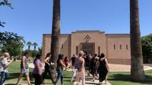Teachers walk into the Phoenix Indian School Visitor Center