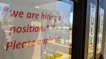 A sign on a Phoenix restaurant advertises open positions