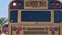 A school bus picking up students