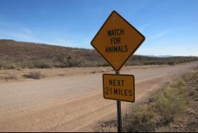A sign on the road to the border barrier