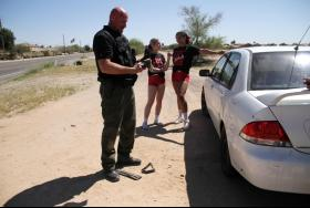 Pinal County Sheriff Mark Lamb changes a tire