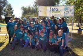 Tucson Punishers pose under the MG Walk banner