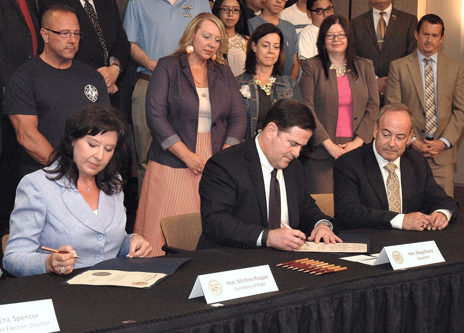 Gov. Doug Ducey, center, certifies the results of the 2016 special election that approved Proposition 123 to add education funds