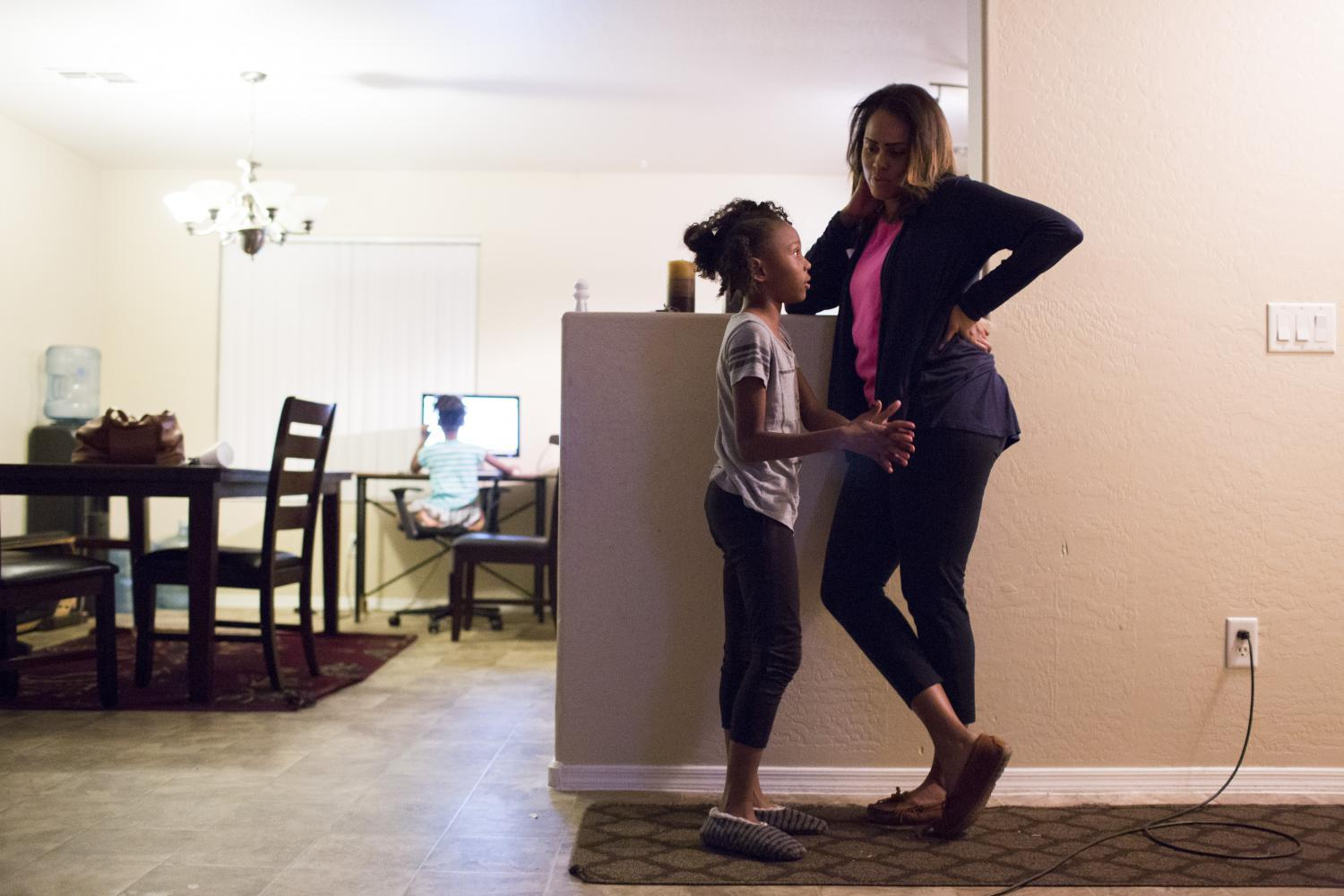 Tracie Ervin catches up with her daughter, Megan, 9.