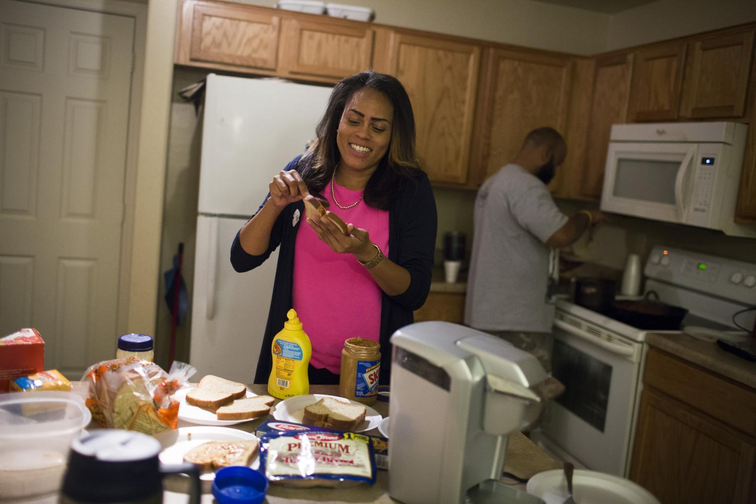 Tracie Ervin makes school lunches for her kids and Michael Ervin prepares dinner.